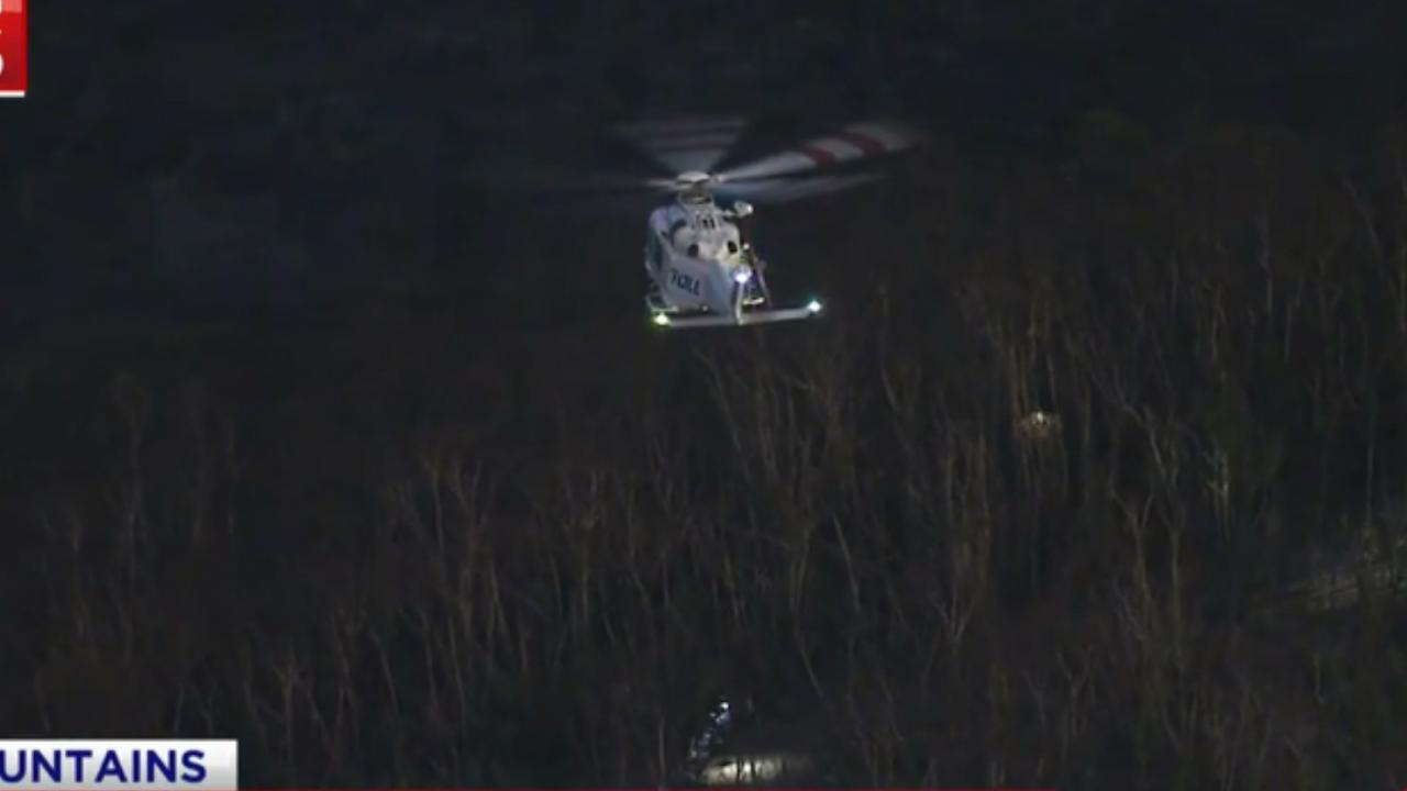 Police attempted to rescue the man last night but were hampered by conditions. Picture: 7 News