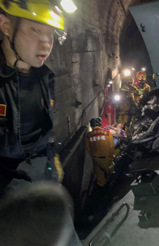 Taiwan Red Cross shows rescue teams at the site where the train derailed. Picture: Taiwan Red Cross/ AFP