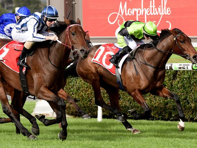Damian Lane hits the line first on Amelie's Star in front of Emily Finnegan on Have Another Glass at Morphettville this month. Picture: Mark Brake