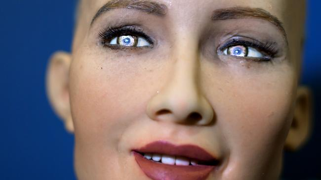 """""""Sophia"""" an artificially intelligent (AI) human-like robot developed by Hong Kong-based humanoid robotics company Hanson Robotics is pictured during the """"AI for Good"""" Global Summit hosted at the International Telecommunication Union (ITU) on June 7, 2017, in Geneva. The meeting aim to provide a neutral platform for government officials, UN agencies, NGO's, industry leaders, and AI experts to discuss the ethical, technical, societal and policy issues related to AI.   / AFP PHOTO / Fabrice COFFRINI"""