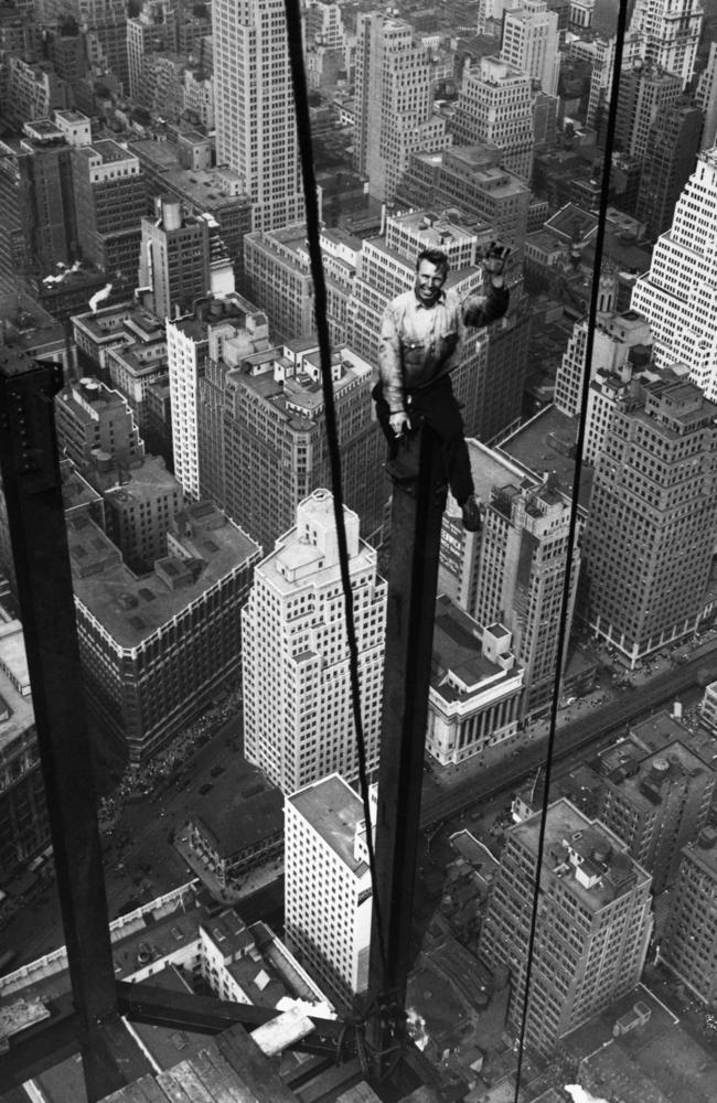 September 13, 1930: Carl Russell waves to his co-workers on the structural work of the 88th floor of the new Empire State Building. Picture: © Bettmann/CORBIS