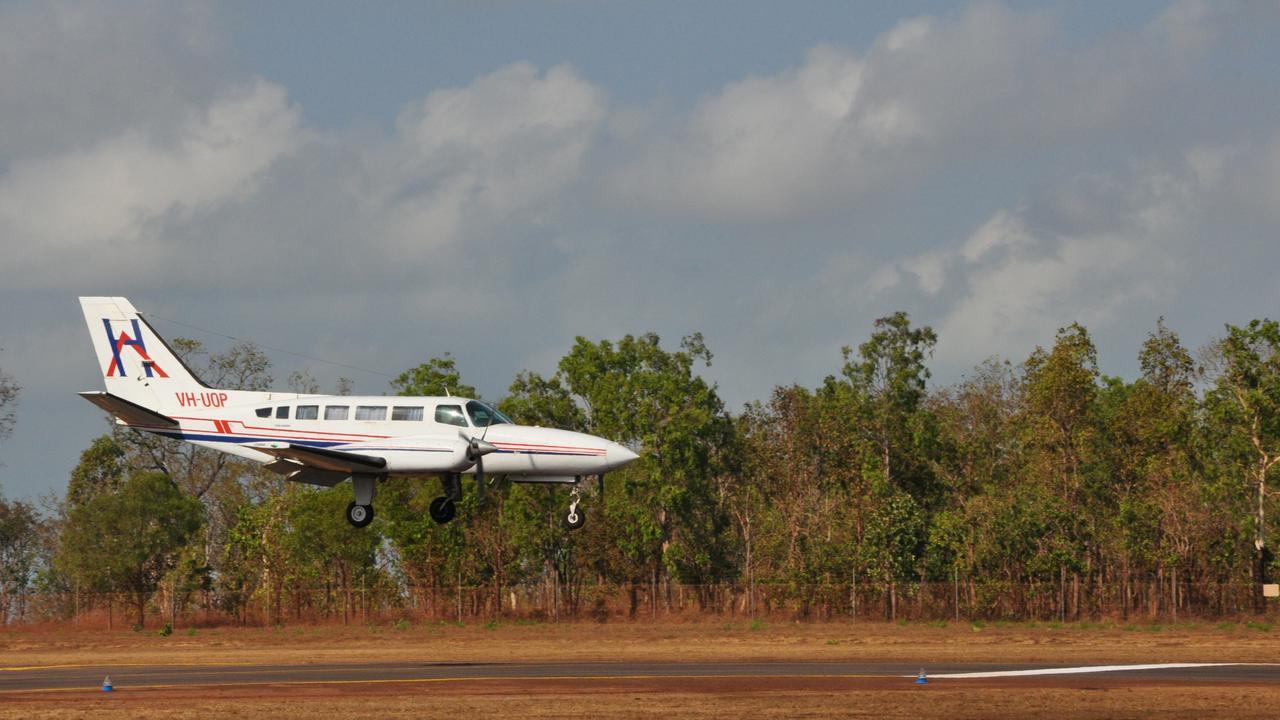 A light plane lands at the renovated Wurrumiyanga airstrip on Bathurst island. Picture: Lauren Roberts