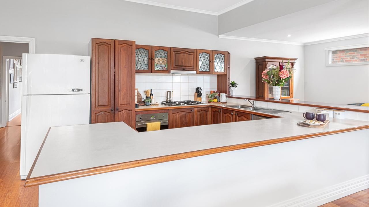 The kitchen draws on the home's character style.