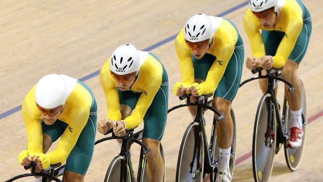 Luke Davison leads the Australian men's pursuit team to gold.