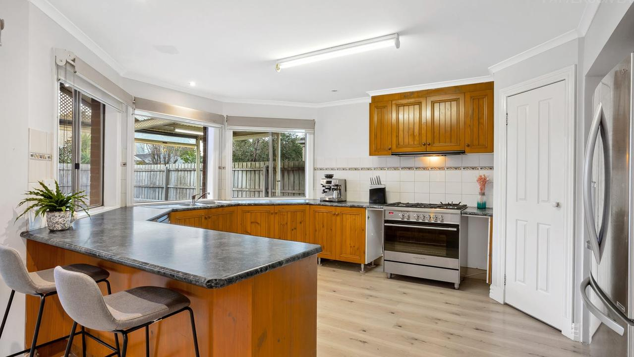 The kitchen has a view of the backyard.