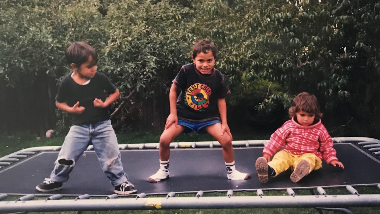 Jillibalu Riley (centre) being a daredevil on the trampoline as a kid. Picture: supplied
