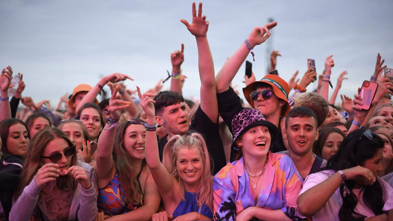Festival-goers watch British rapper AJ Tracey perform on stage at Reading Festival. As Covid-19 infection levels rise across the country, vaccines were offered to revellers throughout the weekend. Picture: Daniel Leal-Olivas/ AFP