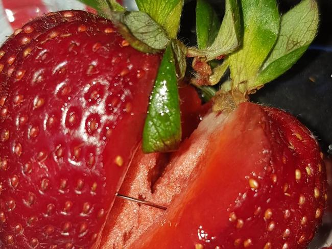 A needle found in a strawberry.
