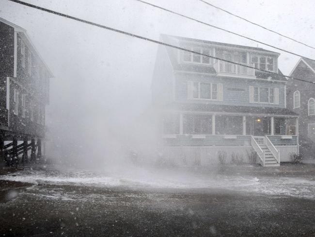 A wave crashes over a house in Scituate, Massachusetts. Picture:  Getty