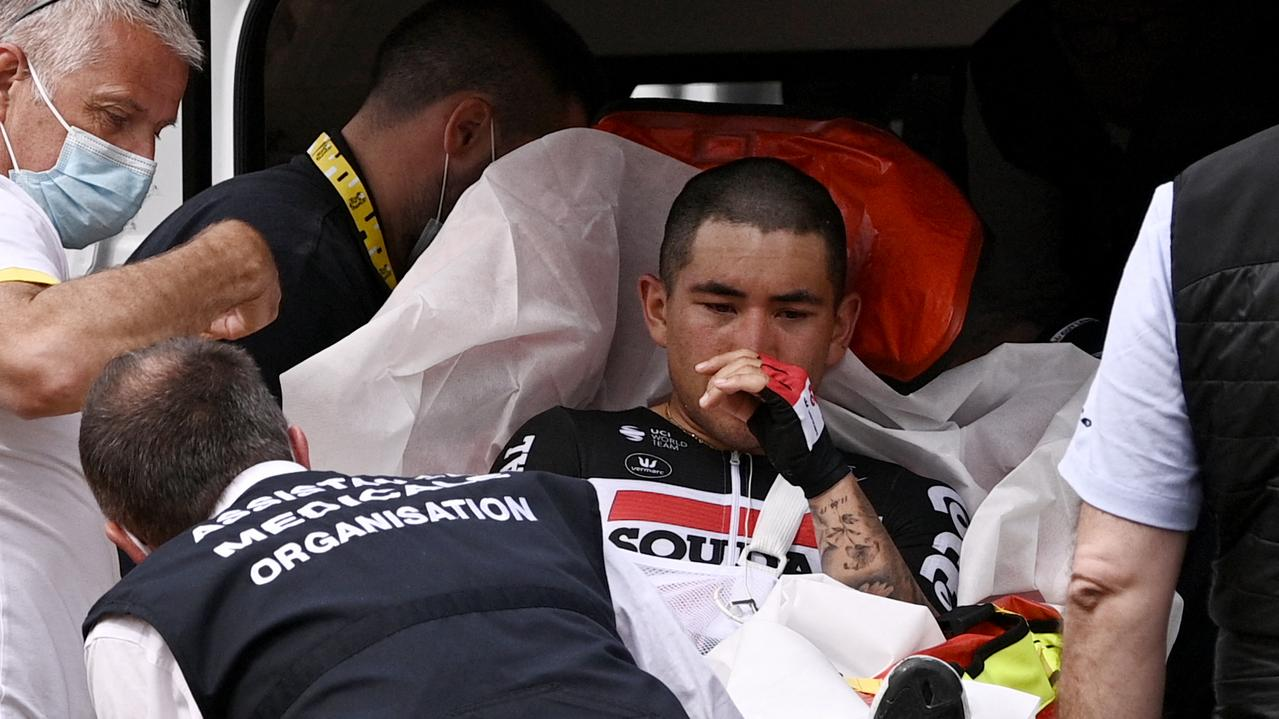 Caleb Ewan is evacuated in an ambulance after his crash (Photo by Anne-Christine POUJOULAT / POOL / AFP)