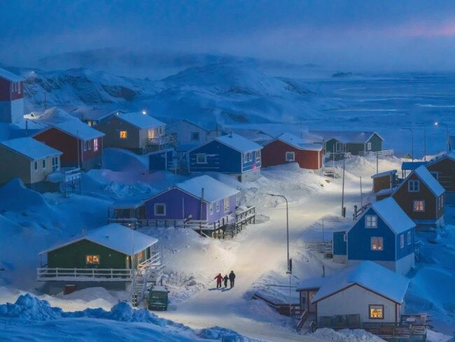 """GRAND PRIZE National Geographic has announced the winners of its 2019 Travel Photo Contest. Chosen from thousands of entries, the grand prize went to Weimin Chu for his photo, """"Winter in Greenland"""". The snapshot depicts the fishing village of Upernavik in northwestern Greenland. Historically, Greenlandic buildings were painted multiple colours to indicate different functions, from red storefronts to blue fishermen's homes — a useful distinction when the landscape is blanketed in snow. Picture: William Chu/National Geographic Travel Photo Contest"""
