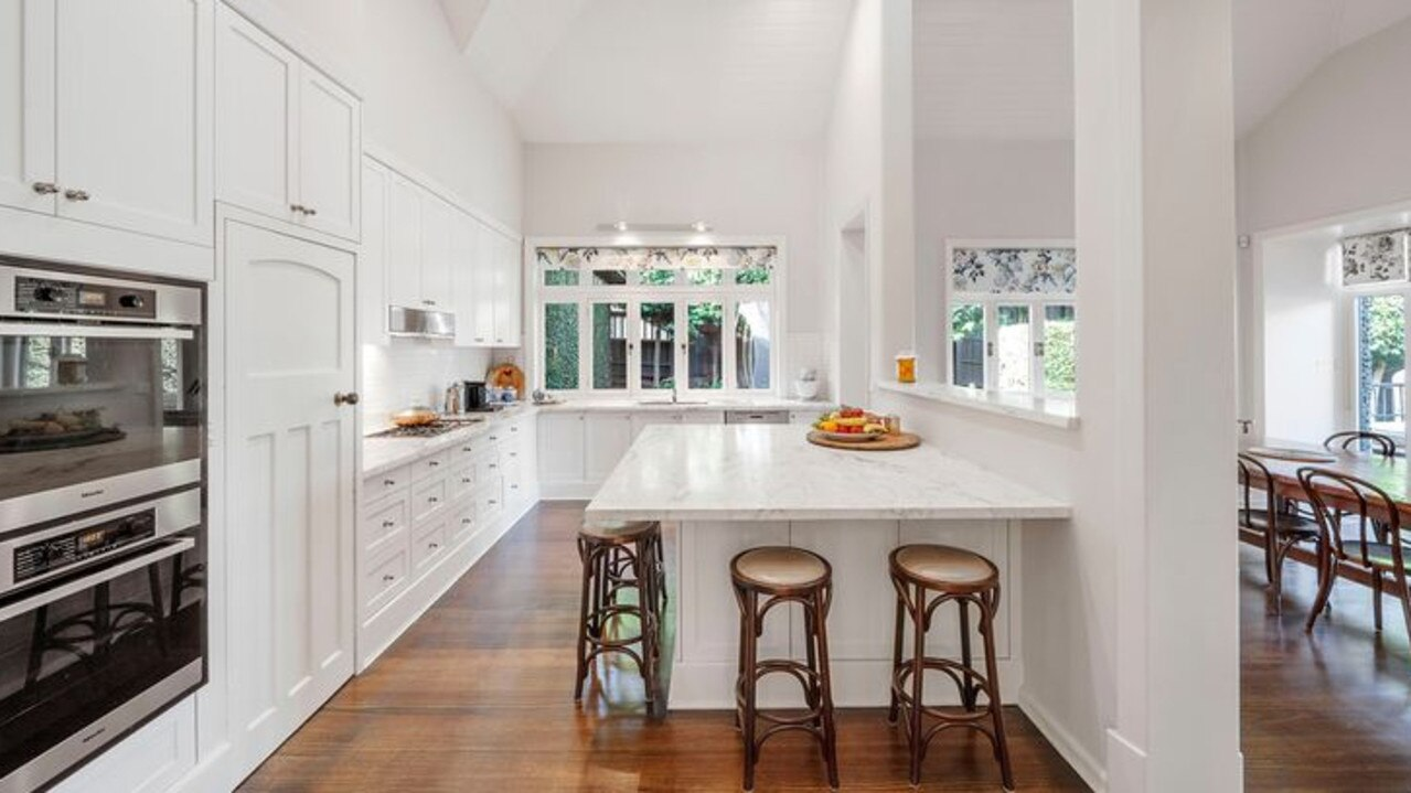 A huge kitchen with built-in dining area.