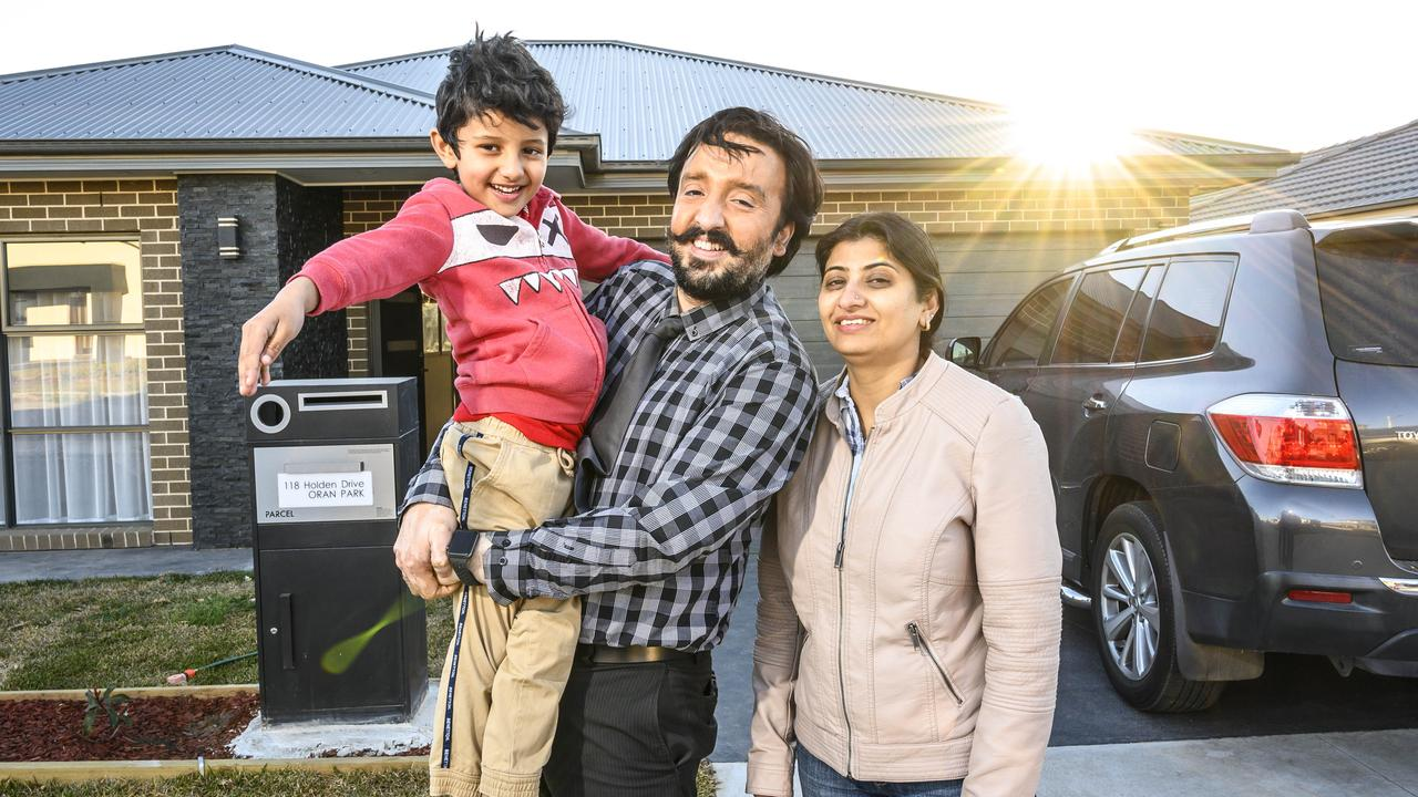Vik Anand and wife Gagan, with son Samuel Singh, moved into a new home. Picture: Darren Leigh Roberts