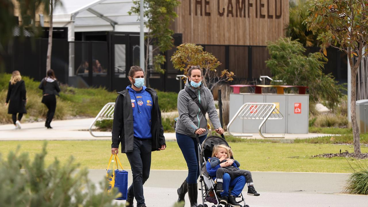 People wear masks outside Optus Stadium before the AFL game between the West Coast Eagles and Western Bulldogs on Sunday. Picture: Paul Kane/Getty Images