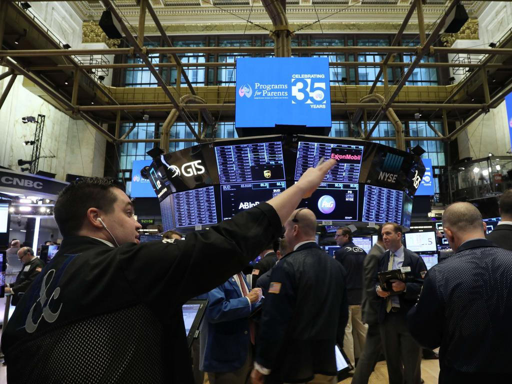 Traders work on the floor of the New York Stock Exchange (NYSE) as a decline in Apple product sales in China continues to depress global markets. Picture: Getty