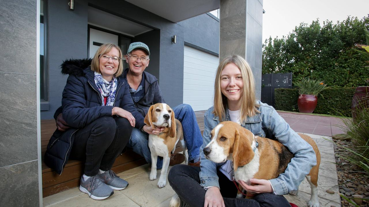 Carol and Justin Burton with their daughter Hannah, 18, and dogs Arnie and Rikki settled on a house and land package Kellyville, Sydney. Picture: Liam Driver
