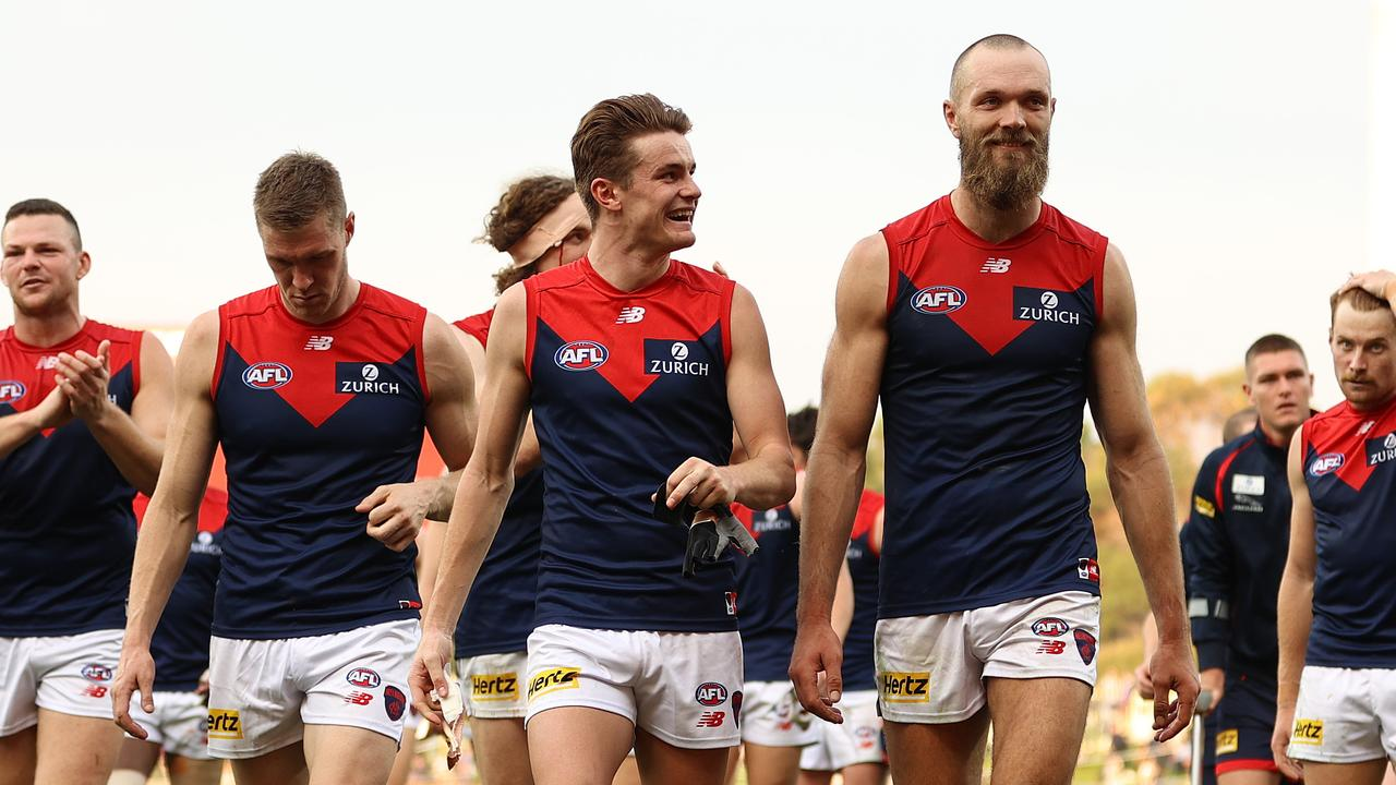 HOBART, AUSTRALIA - MAY 02: The Demons celebrate after they defeated the Kangaroos during the round seven AFL match between the North Melbourne Kangaroos and the Melbourne Demons at Blundstone Arena on May 02, 2021 in Hobart, Australia. (Photo by Robert Cianflone/Getty Images)