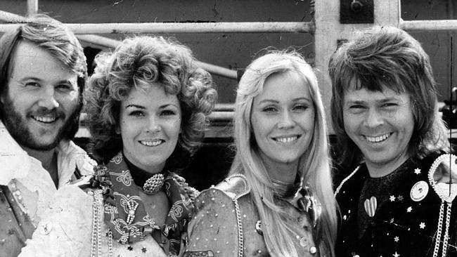Pop music band ABBA says the reason they wore such outrageous outfits on stage was to ens