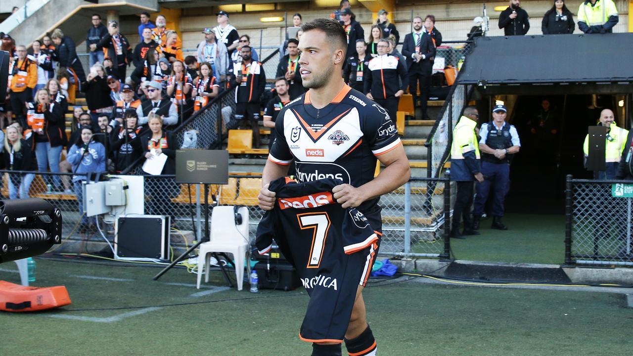 Luke Brooks brings out Tommy Raudonikis' tribute jersey.