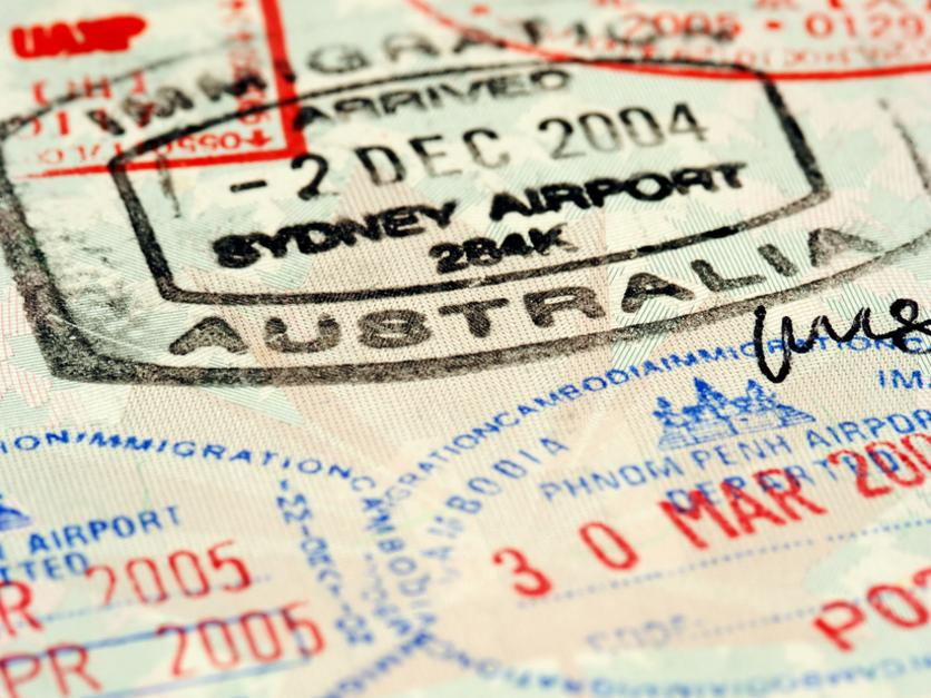 Macro / selective focus image of passport stamps. Focus is on the word Australia.