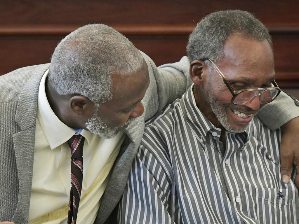 Nathan Myers, left, hugs his uncle, Clifford Williams, during a news conference after their murder convictions were overturned, releasing them from prison after 43 years. Picture: AP