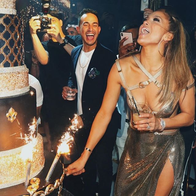 Jennifer Lopez rang in her 50th birthday in a $21k custom Versace dress