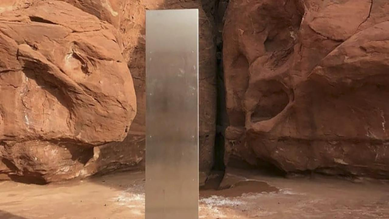 The mystery behind the blink-and-miss shiny metallic monoliths may be solved, after an interview in which stunt artists seemingly claimed responsibility. Picture: Utah Department of Public Safety/AFP