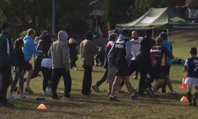 Police called to U7s footy game as brawl erupts between parents