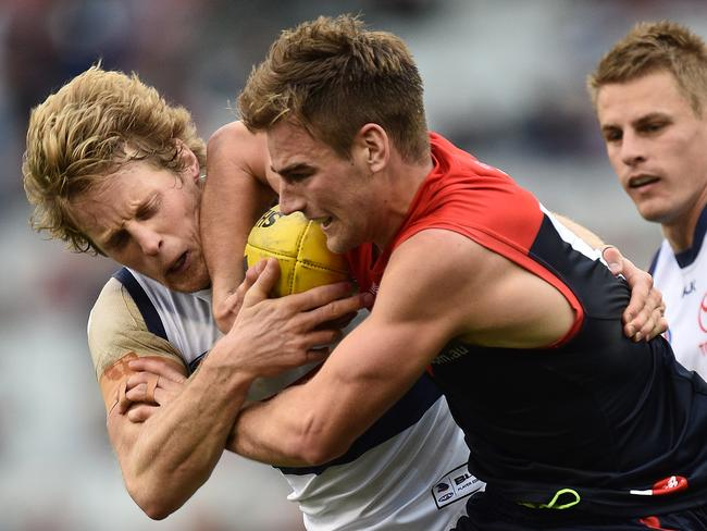 Dom Tyson and Rory Sloane fight for the ball.
