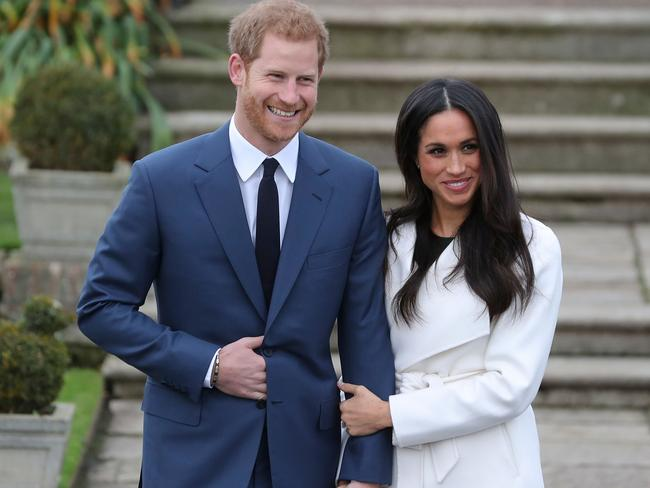 Prince Harry and Meghan Markle beamed as they appeared at Kensington Palace. Picture: AFP/Daniel Leal-Olivas