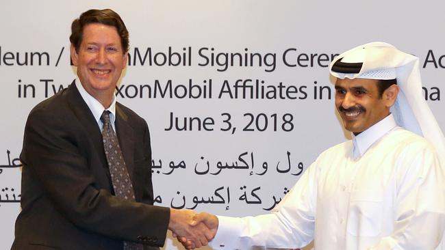 Andrew Swiger, senior vice-president of Exxon, with Saad Sherida Al-Kaabi, president and chief executive of Qatar Petroleum. Picture: AFP