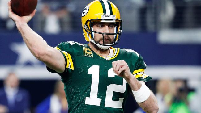 ARLINGTON, TX - JANUARY 15: Aaron Rodgers #12 of the Green Bay Packers throws a pass in the first half during the NFC Divisional Playoff Game against the Dallas Cowboys at AT&T Stadium on January 15, 2017 in Arlington, Texas. Joe Robbins/Getty Images/AFP == FOR NEWSPAPERS, INTERNET, TELCOS & TELEVISION USE ONLY ==