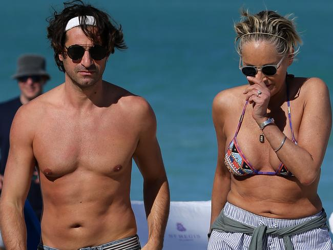 A bikini clad Sharon Stone looks to be wearing an engagement ring as she relaxes with younger boyfriend on the beach in Miami. Picture: MEGA