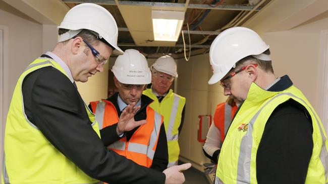 The Minister for Health Michael Ferguson will join representatives of the Royal Hobart Hospital redevelopment Managing Contractor for a tour of major refurbishment works currently underway. Michael Ferguson looks at plans with workers, Ben Moloney, Michael Higgs, Cheryl Carr and Rod Bennett.