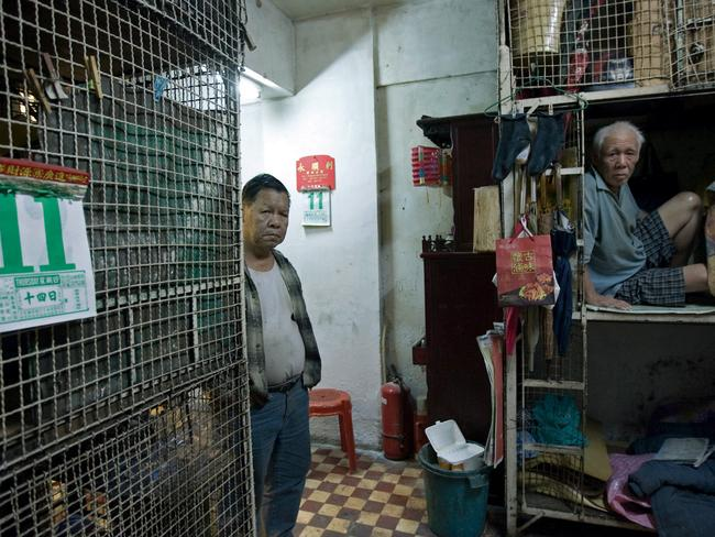 While wealthy young professionals are buying bright and clean 'nano flats', lower socio-economic classes are forced into squalid 'cage flats'. Picture: Alex Hofford