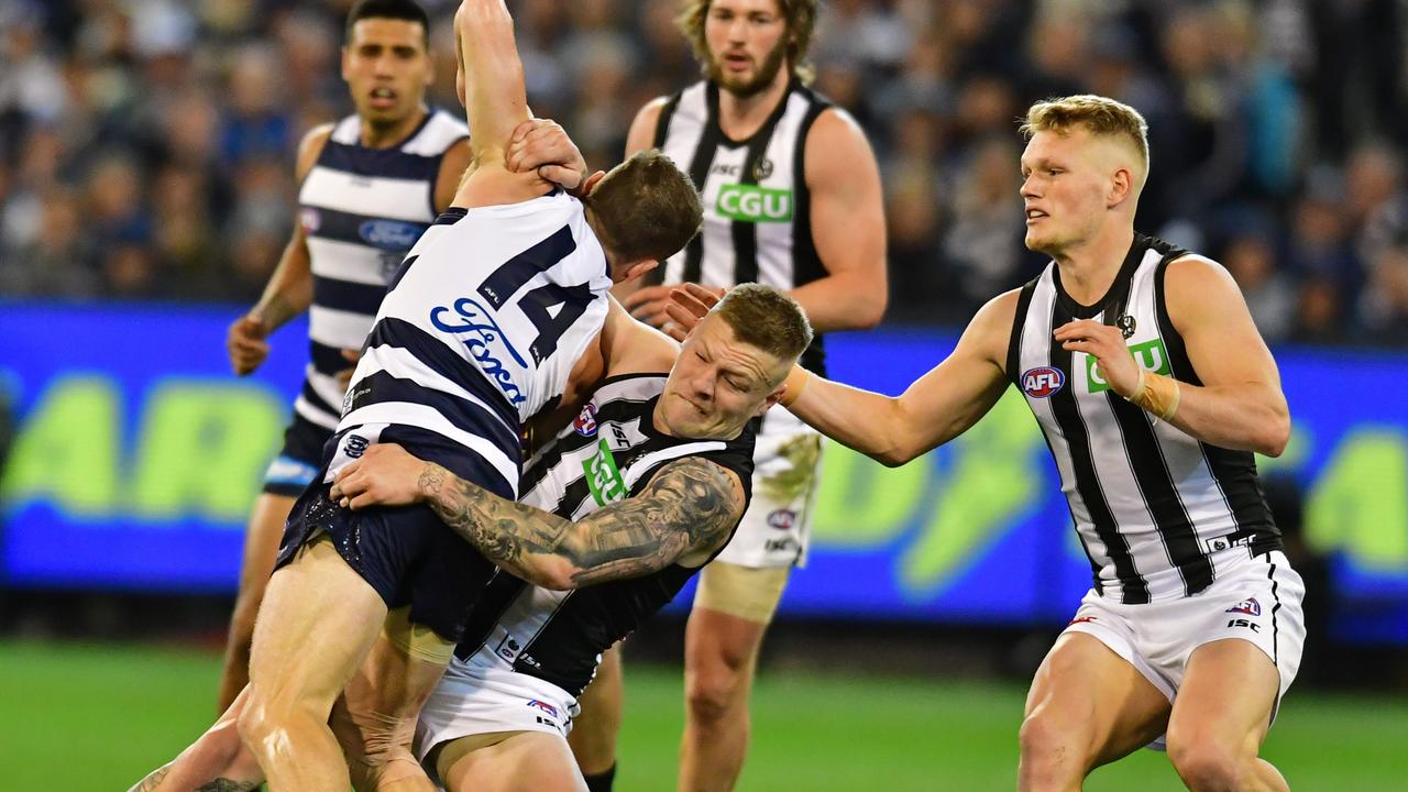 Collingwood and Geelong players grapple last night. Picture: Stephen Harman