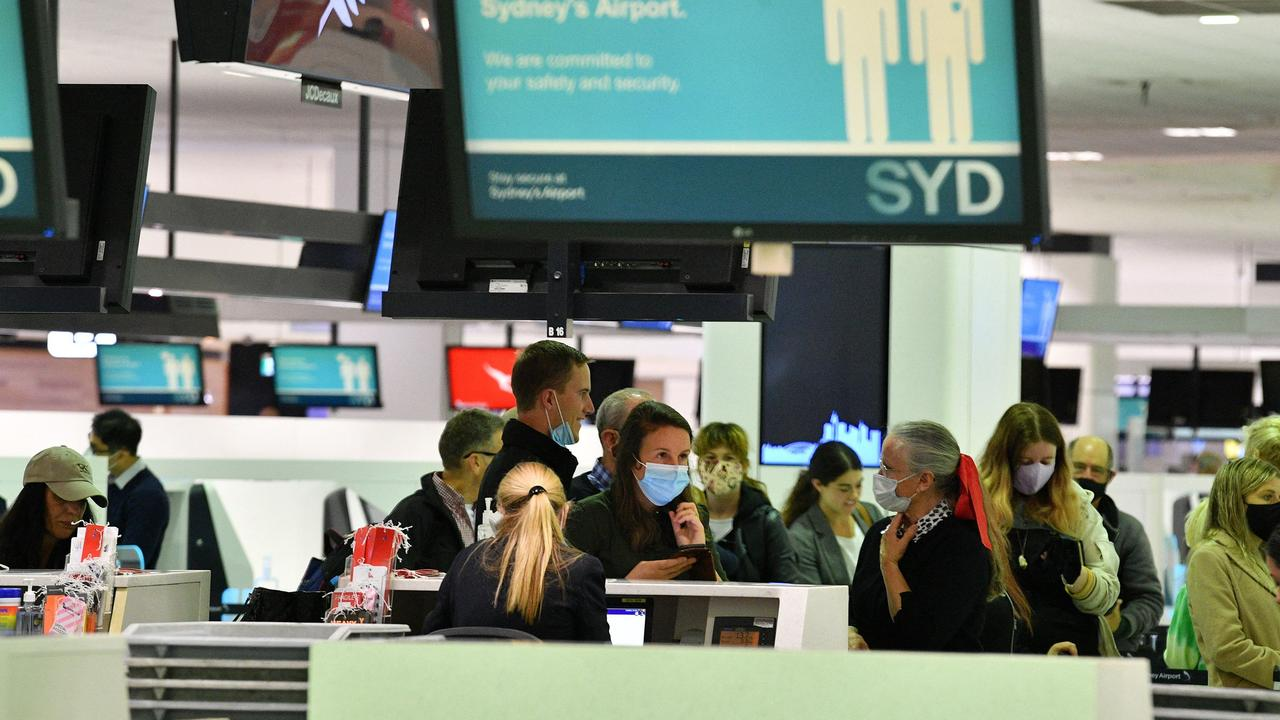 Aussies were quick to snap up flights across the ditch. Picture: Saeed Khan/AFP