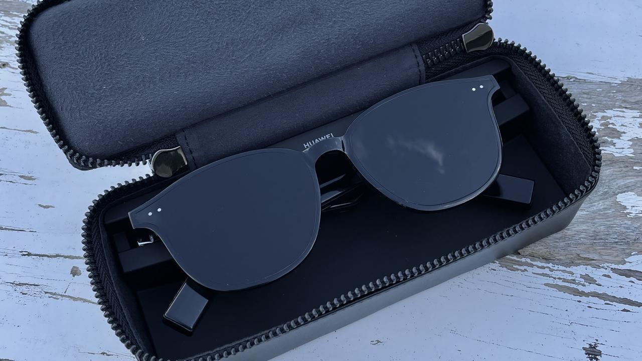 The Huawei Eyewear II in their charging case.