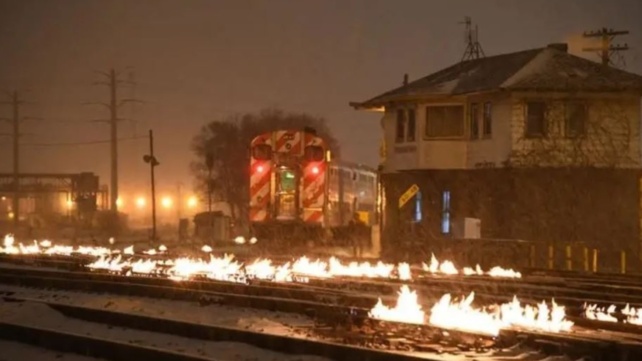 Train tracks in Chicago are lit with fire to stop the points from being clogged with ice and snow. Picture: Metra