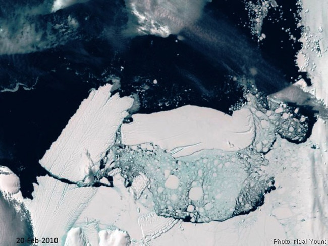 Clash of titans ... A satellite image showing the calving of the Mertz Glacier, left, after it was struck by a 97km-long iceberg in Antarctica. Such a chain of collapses could result in rapid sea level rise. Picture: Australian Antarctic Division.