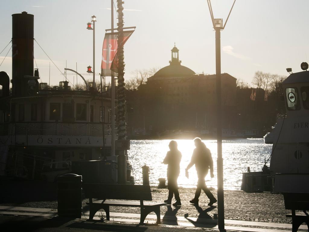People on the quay side in Stockholm in November. Picture: Fredrik SANDBERG / TT News Agency / AFP) / Sweden.