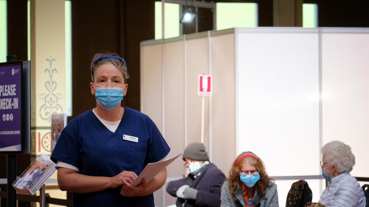 People wait for their vaccination at the Carlton hub. Picture: Getty Images