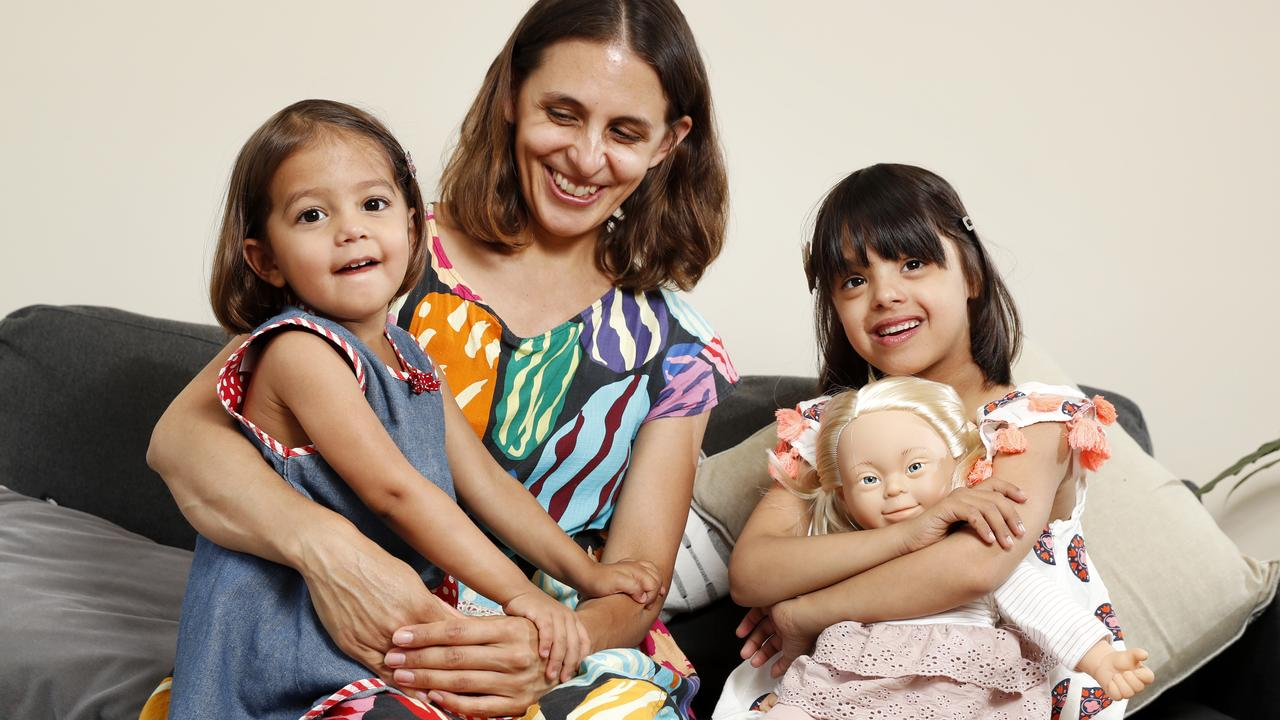 Gemma Namey with daughters Evie, 2, and Isabelle, 6, who has Down Syndrome, with one of the new dolls. Picture: Jonathan Ng