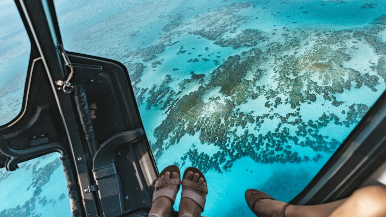 The Great Barrier Reef looks amazing from the air, too — namely, from a helicopter flying out of Cairns.
