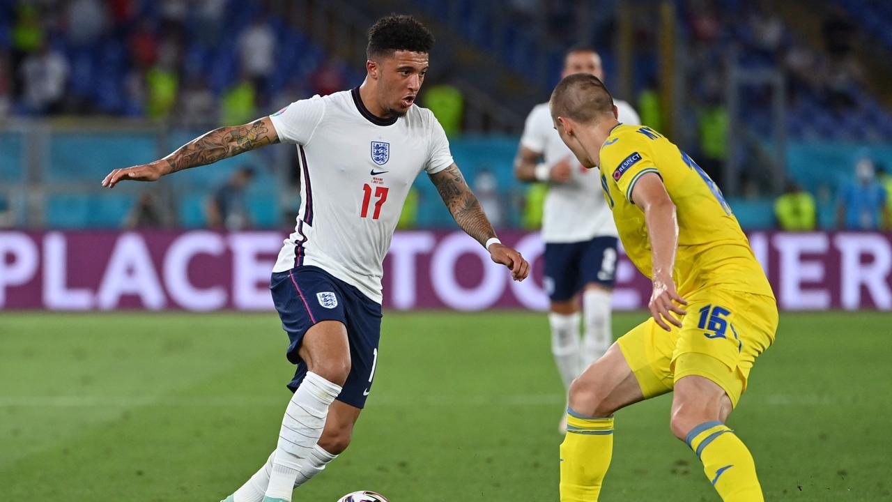 England's forward Jadon Sancho (L) in the UEFA EURO 2020 quarter-final.