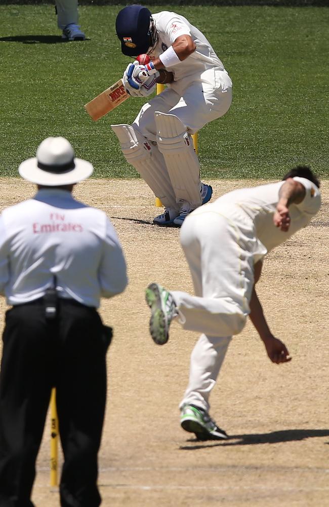 Mitchell Johnson's delivery hits Virat Kohli on his helmet. Getty Images