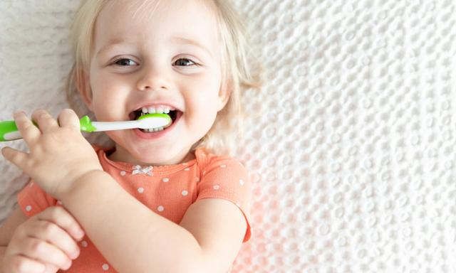 Happy Little Baby with Toothbrush. Dentistry Children's Concept. Copy Space. Smile. Health