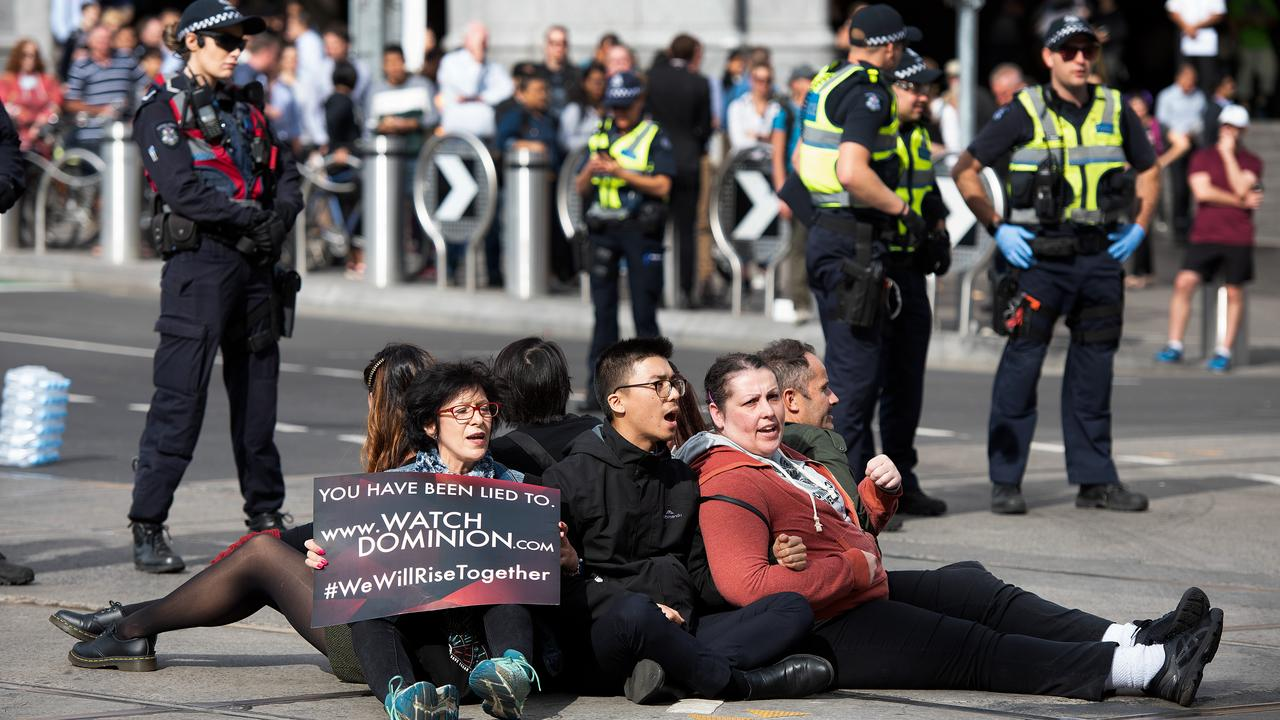 Animal rights protesters are being arrested and dragged into police vans after blocking a major Melbourne CBD intersection. Picture: AAP Image/Ellen Smith