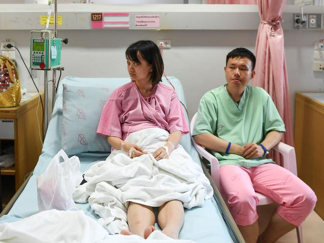 Rescued passengers of the capsized tourist boat in rough seas Wu Jun and his wife Long Hai Ning in hospital in Phuket. Picture: AFP Photo / Mohd Rasfan