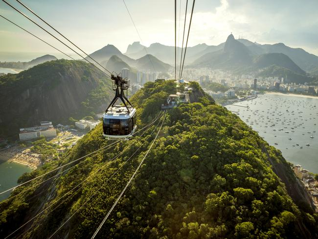 CABLE CAR TO THE TOP OF SUGARLOAF MOUNTAIN, BRAZIL With its concrete high-rises interspersed between green mountains and bright blue sky, Rio de Janeiro is a spectacular sight from above. To get to those views, take a Switzerland-exported cable car up to the top of Sugarloaf Mountain. Along the way, keep your eyes peeled for beaches Flamengo, Copacabana and Ipanema.